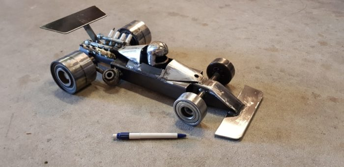 F1 car. Made form different car parts and scrapmetal. About 49 cm long - COLNIC Design
